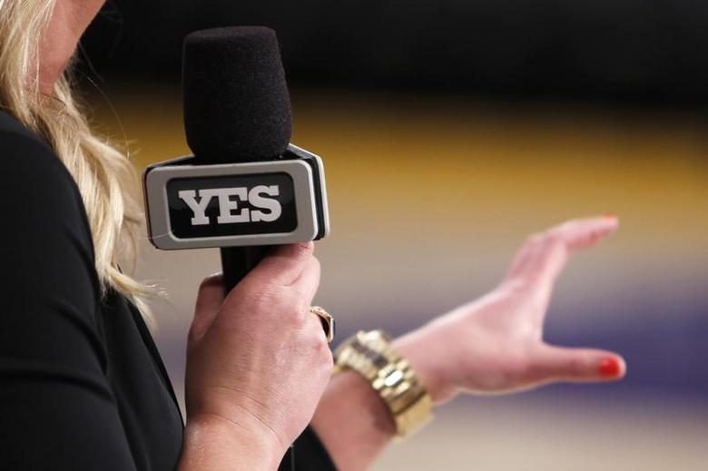 A reporter for the YES Network talks on the court before the Los Angeles Lakers play against the Brooklyn Nets in a NBA basketball game in Los Angeles November 20, 2012. REUTERS/Danny Moloshok