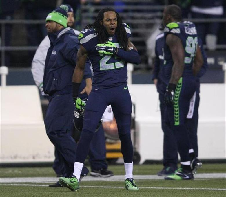 Seattle Seahawks cornerback Richard Sherman taunts San Francisco 49ers players during the fourth quarter in the NFL's NFC Championship football game in Seattle, January 19, 2014. REUTERS/David Ryder
