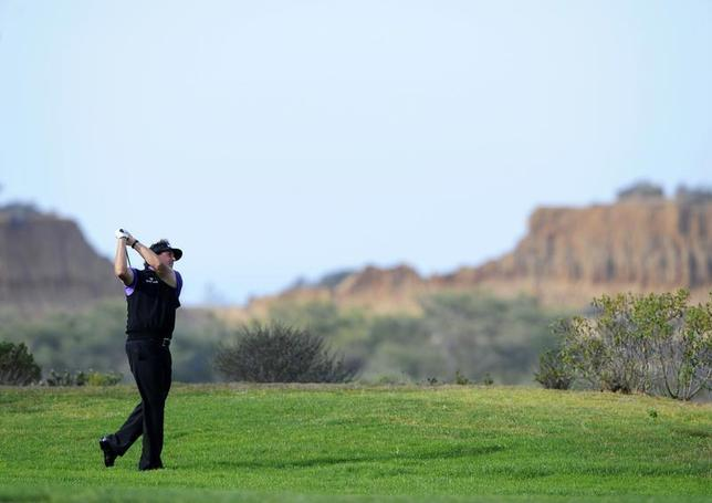 Jan 23, 2014; La Jolla, CA, USA; Phil Mickelson watches his second shot on the eighth hole during the first round of the Farmers Insurance Open golf tournament at Torrey Pines Municipal Golf Course. Mandatory Credit: Christopher Hanewinckel-USA TODAY Sports - RTX17RW3