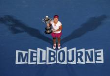 Li Na of China poses with The Daphne Akhurst Memorial Cup after defeating Dominika Cibulkova of Slovakia in their women's singles final match at the Australian Open 2014 tennis tournament in Melbourne January 25, 2014. REUTERS/David Gray