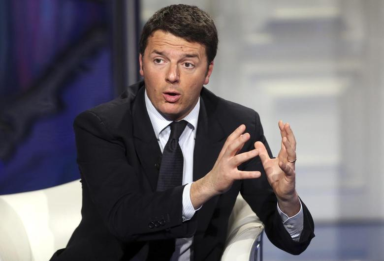 Italy's centre-left Democratic Party (PD) leader Matteo Renzi gestures as he appears as a guest on the RAI television show Porta a Porta (Door to Door) in Rome January 21, 2014.