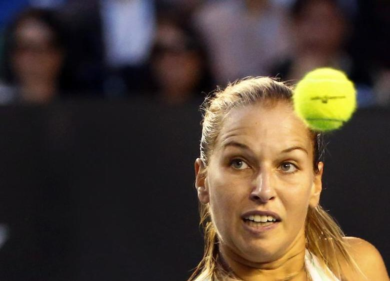 Dominika Cibulkova of Slovakia watches the ball as she hits a return to Li Na of China during their women's singles final match at the Australian Open 2014 tennis tournament in Melbourne January 25, 2014. REUTERS/Petar Kujundzic