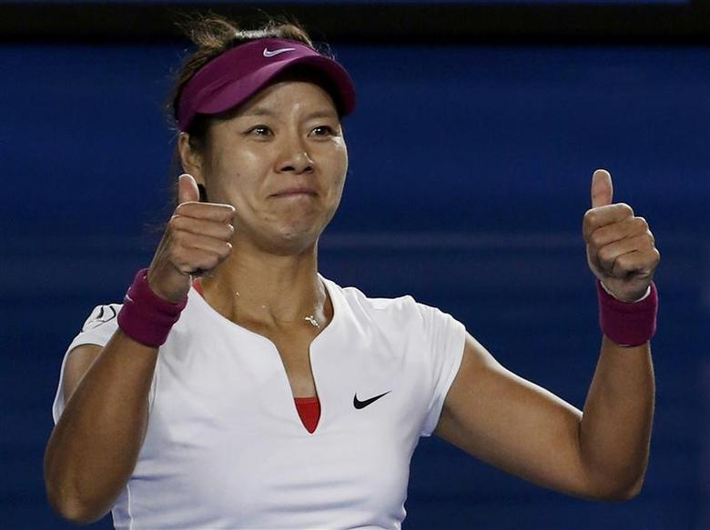 Li Na of China celebrates defeating Dominika Cibulkova of Slovakia in their women's singles final match at the Australian Open 2014 tennis tournament in Melbourne January 25, 2014. REUTERS/Jason Reed