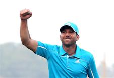 Spain's Sergio Garcia celebrates after his eagle putt on the 18th green during the final round of Qatar Masters at the Doha Golf Club January 25, 2014. REUTERS/Fadi Al-Assaad
