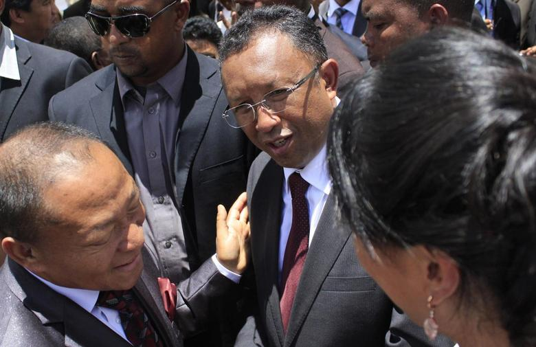 Hery Rajaonarimampianina (C) is congratulated after he was declared Madagascar's president-elect by the electoral court in Antananarivo January 17, 2014 file photo. REUTERS/John Friedrich Rabenandro