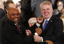 Mayors Michael Hancock of Denver (L) and Ed Murray of Seattle pose for pictures as they pretend to fight for the upcoming Super Bowl XLVIII between the Denver Broncos and Seattle Seahawks at a reception with U.S. mayors at the White House in Washington January 23, 2014. REUTERS/Yuri Gripas