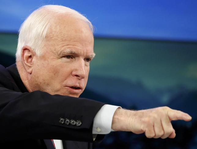U.S. Senator John McCain gestures during a session at the annual meeting of the World Economic Forum (WEF) in Davos January 24, 2014. REUTERS/Ruben Sprich
