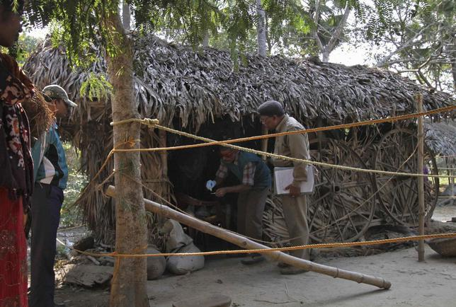 A forensic expert collects samples from an area where a woman was gang-raped at Birbhum district in the eastern Indian state of West Bengal January 25, 2014. India's Supreme Court on Friday ordered an investigation into the gang rape of the 20-year-old woman from an eastern tribal region by 13 men on the orders of a village court, a case that has sparked protests demanding swift justice. REUTERS/Stringer