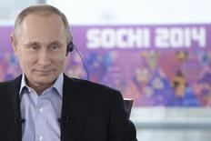 Russian President Vladimir Putin listens to a journalist's question during a televised news conference in Sochi January 19, 2014. REUTERS/Alexei Nikolsky/RIA Novosti/Kremlin