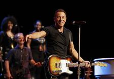 Singer Bruce Springsteen greets journalists during a sound check session ahead of his concert in Cape Town, January 26, 2014. REUTERS/Mike Hutchings