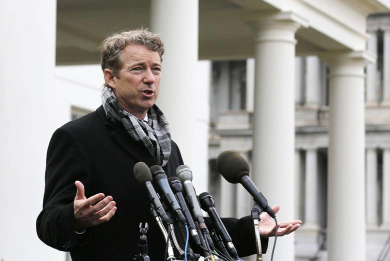 U.S. Rep. Rand Paul (R-KY) speaks outside the White House after President Barack Obama announced the first five ''Promise Zones,'' as a way to create jobs, in Washington January 9, 2014. REUTERS/Larry Downing