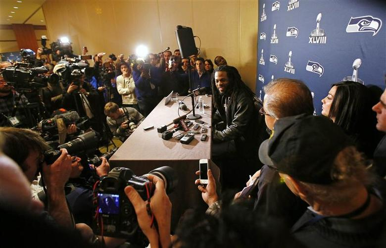 Seattle Seahawks cornerback Richard Sherman speaks during a news conference after the team's arrival for Super Bowl XLVIII against the Denver Broncos in Jersey City, New Jersey, January 26, 2014. REUTERS/Adam Hunger