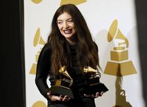 "Pop singer Lorde poses backstage with her awards for song of the year for ""Royals"" and best pop solo performance for ""Royals"" at the 56th annual Grammy Awards in Los Angeles, California January 26, 2014. REUTERS/Danny Moloshok"