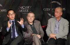 "Lawrence Ho (L), Co-chairman and Chief Executive Officer (CEO) of Melco Crown Entertainment Limited, gestures next to actor Robert De Niro (C) and celebrity chef Nobuyuki ""Nobu"" Matsuhisa during a news conference in Manila January 27, 2014. REUTERS/Romeo Ranoco"