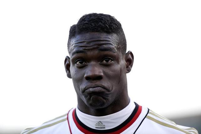 AC Milan's Mario Balotelli reacts during the Italian Serie A soccer match against Cagliari at the Sant'Elia stadium in Cagliari January 26, 2014. REUTERS/Max Rossi