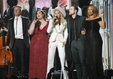 "Macklemore, Mary Lambert, Madonna, Ryan Lewis and Queen Latifah (L-R) perform ""Same Love"" at the 56th annual Grammy Awards in Los Angeles, California January 26, 2014. REUTERS/ Mario Anzuoni"