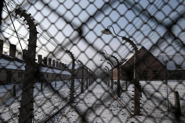 Former Auschwitz concentration camp is pictured through a fence during ceremonies to mark the 69th anniversary of the liberation and commemorate the victims of the Holocaust in Auschwitz January 27, 2014. REUTERS/Kacper Pempel