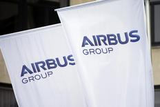 Flags with the new logo of aircraft manufacturer Airbus Group are seen on the entrance gate of the company's office building in Paris January 3, 2014. REUTERS/Benoit Tessier