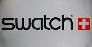 The logo of Swiss watchmaker Swatch is seen on the door of a Swatch watches shop in Strasbourg March 12, 2009. REUTERS/Vincent Kessler