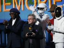 "Producer Paul Williams accepts the award for Album of the year for Daft Punk's ""Random Access Memories"" as Nile Rodgers (L) and Pharrell Williams applaud at the 56th annual Grammy Awards in Los Angeles, California January 26, 2014. REUTERS/Mario Anzuoni"