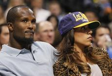 Denver Broncos cornerback Champ Bailey watches the Denver Nuggets play the Los Angeles Lakers with an unidentified woman in Game 4 of their NBA Western Conference basketball playoffs in Denver May 6, 2012. REUTERS/Rick Wilking