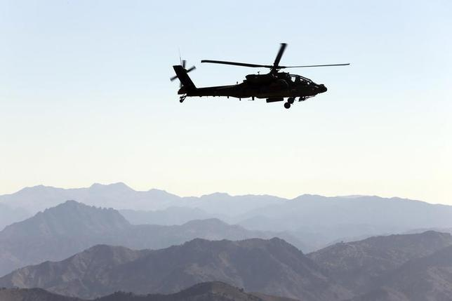 A U.S Army Apache helicopter flies near the town of Walli Was during an operation in Paktika province, near the border with Pakistan November 2, 2012. REUTERS/Goran Tomasevic