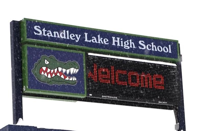 A sign outside Standley Lake High School is seen on a snow-covered hill in Westminster, Colorado January 27, 2014. REUTERS/Rick Wilking