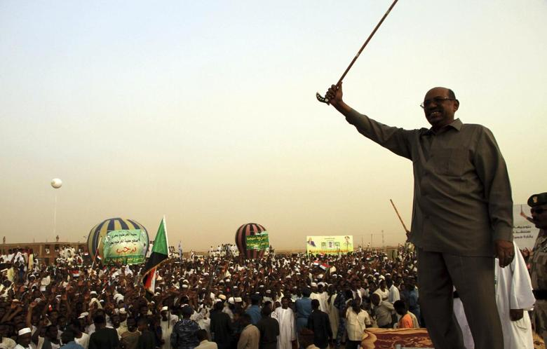 President Omar Hassan al-Bashir addresses a crowd in North Khartoum, June 8, 2013. REUTERS/Stringer