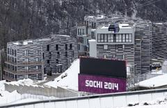 Appartment buildings are pictured next to the Sanki sliding center at the Rosa Khutor Alpine Resort in Krasnaya Polyana near Sochi, January 26, 2014. REUTERS/Fabrizio Bensch