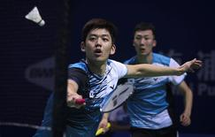 South Korea's Lee Yong-dae (L) hits a return next to his partner Yoo Yeon-seong during their men's doubles semi-final match against Japan's Hiroyuki Endo and Kenichi Hayakawa at the China Open Badminton Tournament in Shanghai, November 16, 2013. REUTERS/Stringer