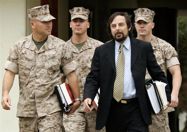 U.S. Marine Sgt. Lawrence G. Hutchins III (back R) arrives with his civilian defence counsel J. Richardson Brannon (front R) and military defence counsel Lt Col Joseph S. Smith (front L) and Captain Alan Bass for his Article 32 Investigation hearing at Camp Pendleton, California, in this October 16, 2006 file photo. REUTERS/Mike Blake/Files