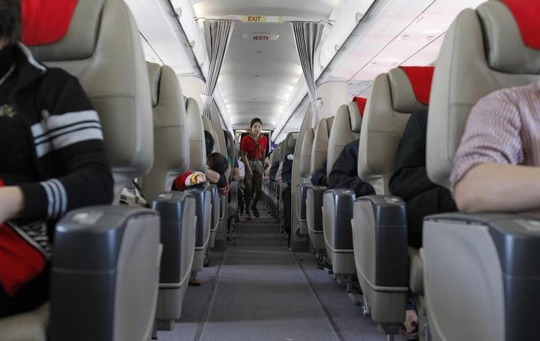 A VietJetAir flight attendant walks along the aisle during a flight from Hanoi to Ho Chi Minh city March 2, 2012. REUTERS/Kham