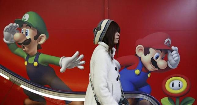 A shopper rides an escalator past Nintendo advertisements at an electronics retail store in Tokyo January 20, 2014. REUTERS/Yuya Shino