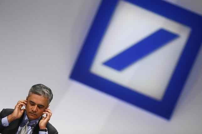 Anshu Jain, Co-chief Executive of Deutsche Bank adjusts his headphones during a shareholders meeting in Frankfurt, in this May 23, 2013 file picture. London police said on January 28, 2014 they had found the body of a man hanging in a house in central London, after Deutsche bank had announced the death of its former executive William Broeksmit. REUTERS/Ralph Orlowski/files
