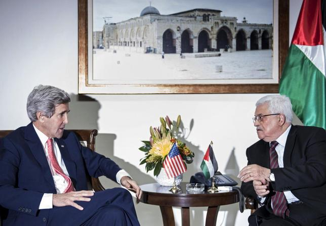 U.S. Secretary of State John Kerry (L) and Palestinian president Mahmoud Abbas talk before a meeting at the presidential compound in the West Bank city of Ramallah January 3, 2014. REUTERS/Brendan Smialowski/Pool