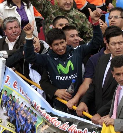 Colombian cyclist Nairo Quintana (gesturing) greets fans upon his arrival at Bogota Airport August 13, 2013. REUTERS/Jose Miguel Gomez