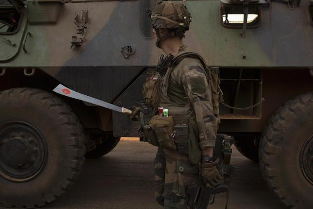 A French peacekeeping soldier holds a confiscated machete in the centre of the capital Bangui January 25, 2014. REUTERS/Siegfried Modola