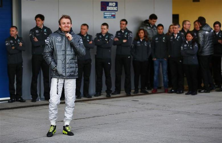 Mercedes Formula One racing driver Nico Rosberg of Germany stands before unveiling the new Mercedes F1 W05 car during its official presentation at the Jerez racetrack in southern Spain January 28, 2014. REUTERS/Marcelo del Pozo
