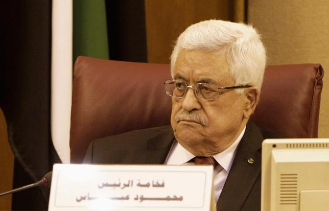 Palestinian President Mahmoud Abbas attends the Arab League Foreign Ministers emergency meeting at the League's headquarters in Cairo, December 21, 2013. REUTERS/ Mohamed Abd El Ghany