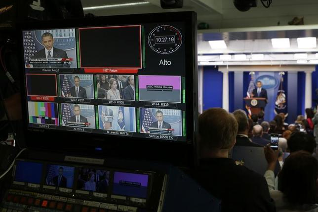 U.S. President Barack Obama is seen on a network video distribution console while he talks about the economy in the White House Press Briefing Room in Washington, June 8, 2012. REUTERS/Larry Downing