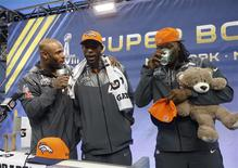 Denver Broncos free safety Mike Adams (L) interviews teammates Dominique Rodgers-Cromartie (C) and Danny Trevathan during Media Day for Super Bowl XLVIII at the Prudential Center in Newark, New Jersey January 28, 2014. REUTERS/Shannon Stapleton