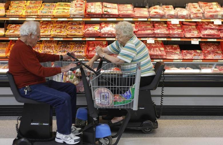 Customers shop for meat at Wal-Mart in Rogers, Arkansas, June 4, 2009. REUTERS/Jessica Rinaldi