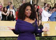 "Actress Oprah Winfrey from the film ""The Butler"" arrives at the 20th annual Screen Actors Guild Awards in Los Angeles, California January 18, 2014. REUTERS/Lucy Nicholson"