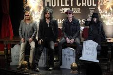 Members of rock band Motley Crue (L-R) Vince Neil, Nikki Sixx, Tommy Lee and Mick Mars pose at a news conference announcing The Final Tour in Hollywood, California January 28, 2014. REUTERS/Mario Anzuoni