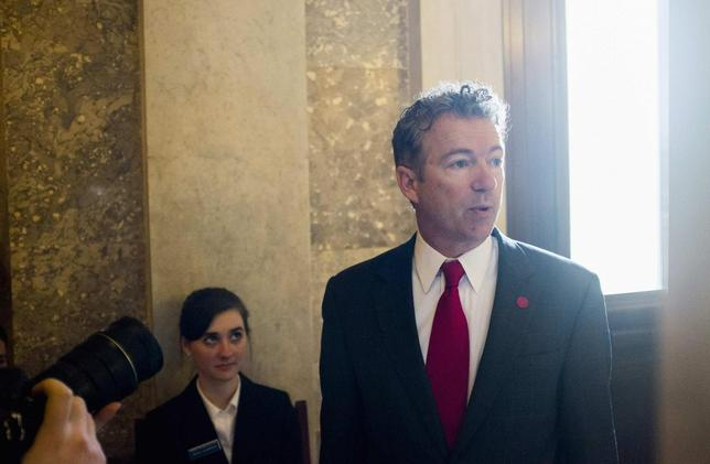 Senator Rand Paul (R-KY) arrives for the Republican weekly policy luncheon on Capitol Hill in Washington January 28, 2014. REUTERS/Joshua Roberts