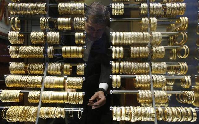 A goldsmith arranges gold bangles at a jewellery shop at the Grand Bazaar in Istanbul December 5, 2013. REUTERS/Murad Sezer/Files