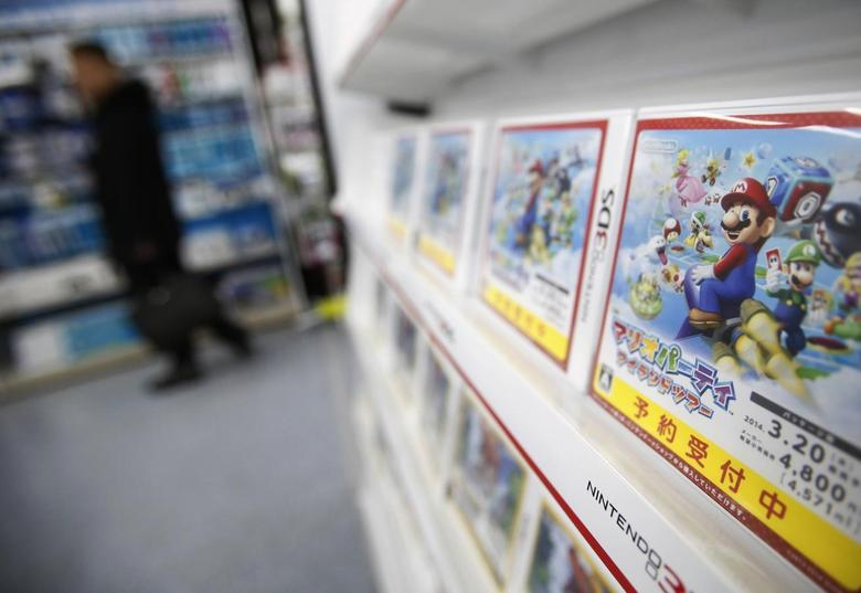 A man looks at items and accessories for Nintendo Co's Wii U game consoles, as its 3DS portable game console software are displayed at an electronics retail store in Tokyo January 20, 2014. REUTERS/Yuya Shino