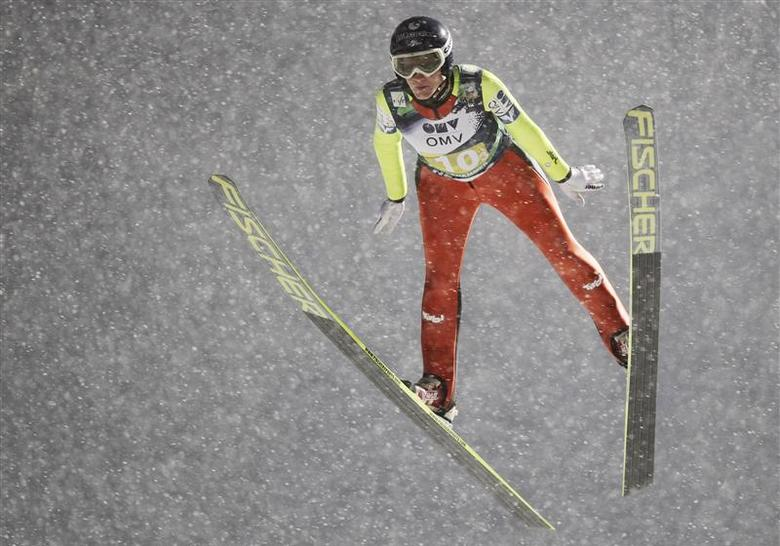 Daniela Iraschko of Austria competes during the FIS World Cup ski jumping mixed team competition in Lillehammer, December 6, 2013. REUTERS/Geir Olsen/TT News Agency
