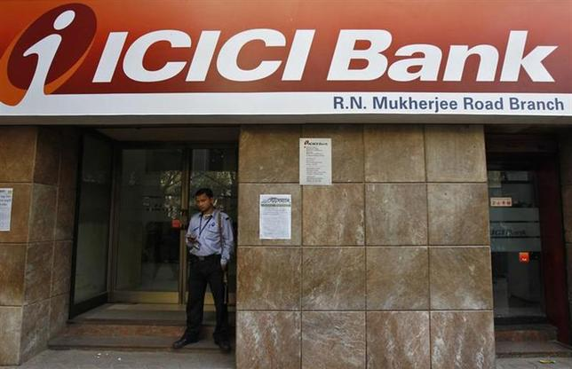 A private security personnel stands guard outside an ICICI Bank branch in Kolkata January 29, 2014. doubled. REUTERS/Rupak De Chowdhuri/Files
