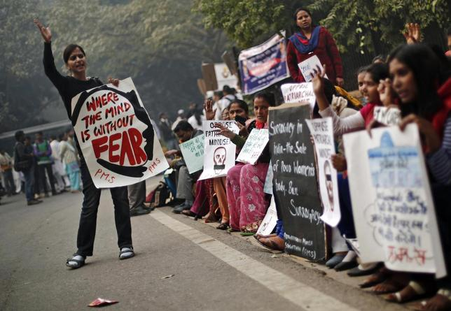 Protesters carry placards as they shout slogans during a protest to mark the first anniversary of the Delhi gang rape, in New Delhi December 16, 2013. REUTERS/Adnan Abidi